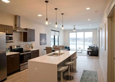 Apartment Kitchen and Living Room in Homes at River's Edge